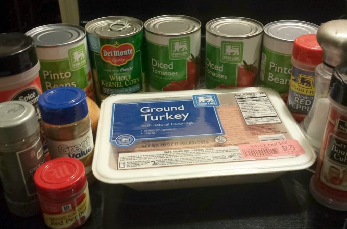 Ingredients to make chili with ground turkey, corn and beans