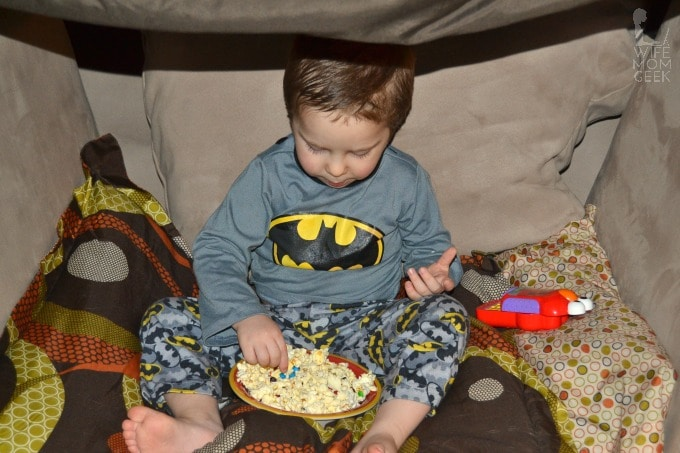 In the Pop Secret Pillow Fort enjoying his popcorn