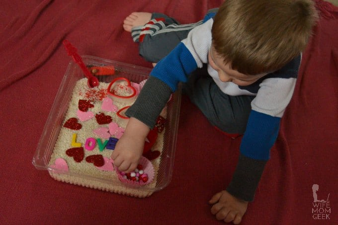 Son Playing with Valentine Sensory Bin