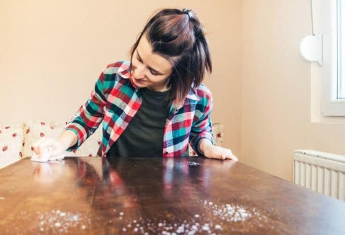 woman wiping down a table