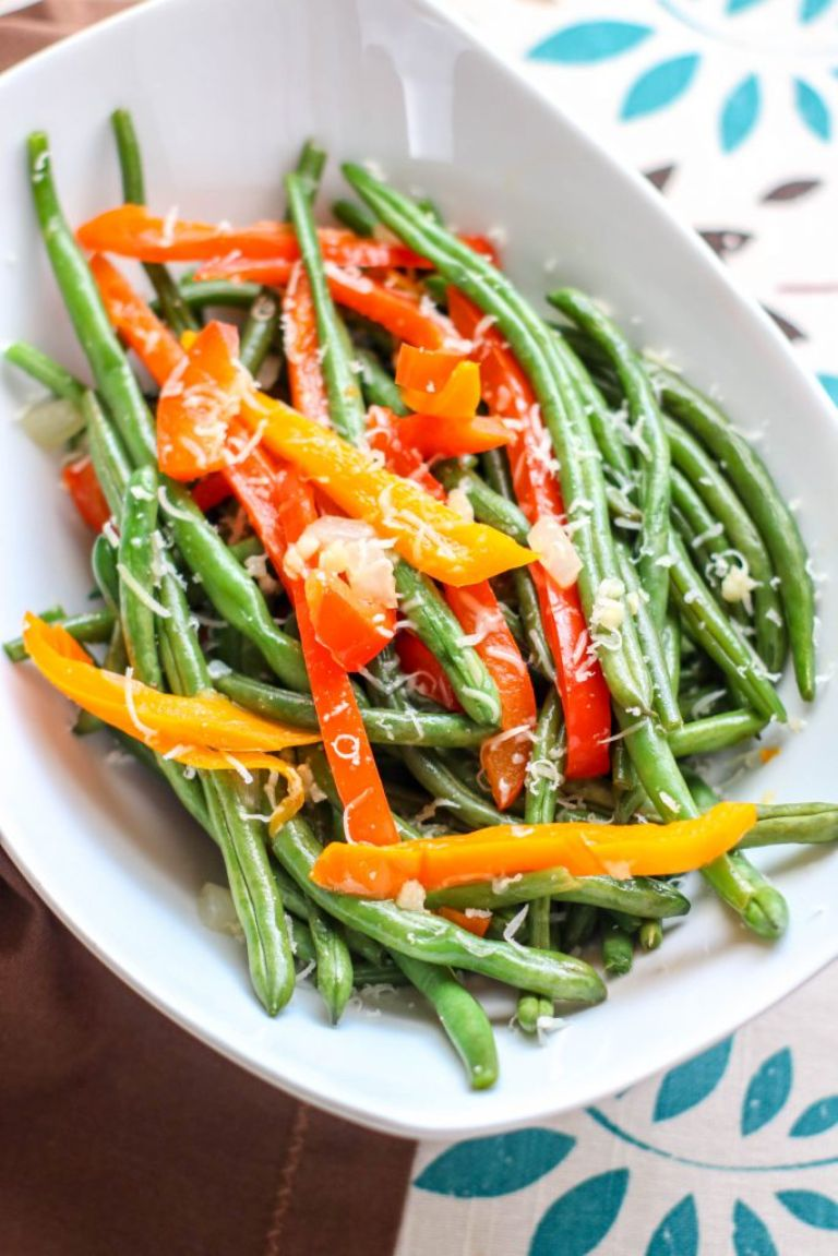 green beans and peppers with sprinkled parmesan