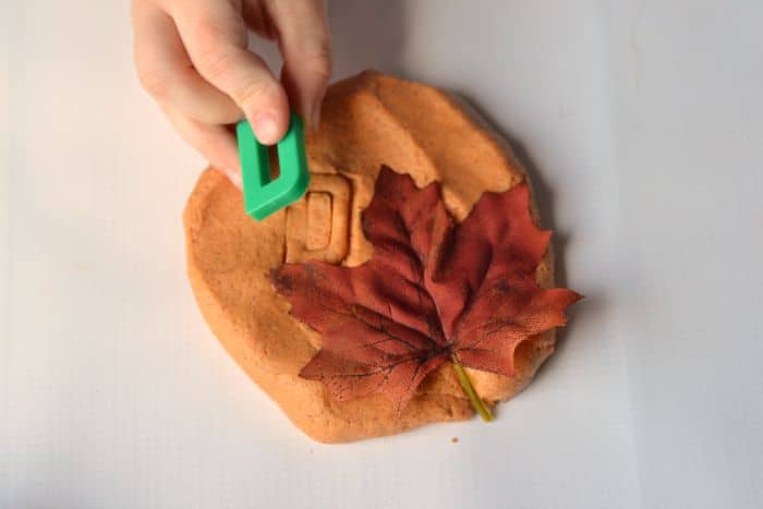 Leaf impressions with pumpkin pie playdough
