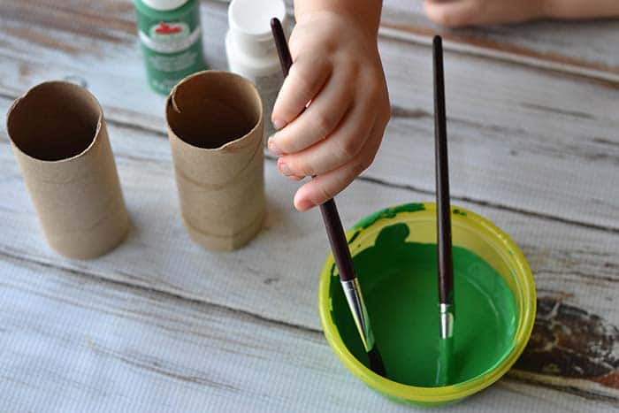 painting toilet paper tubes green