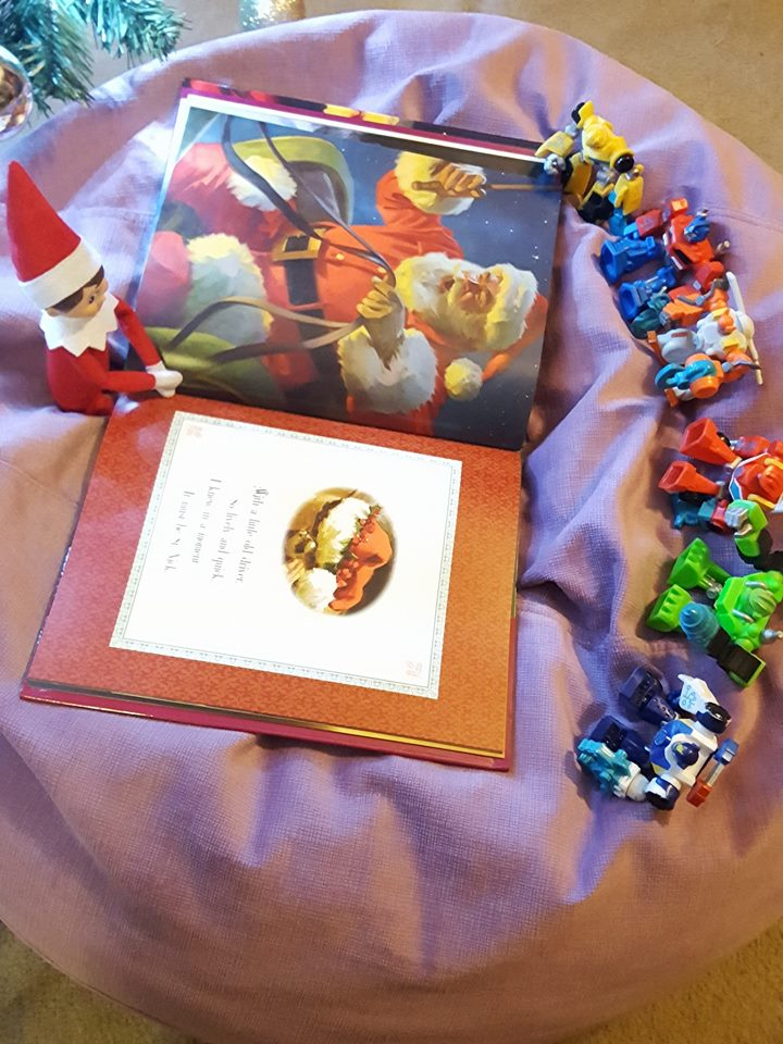 Elf reads The Night Before Christmas to the Transformers