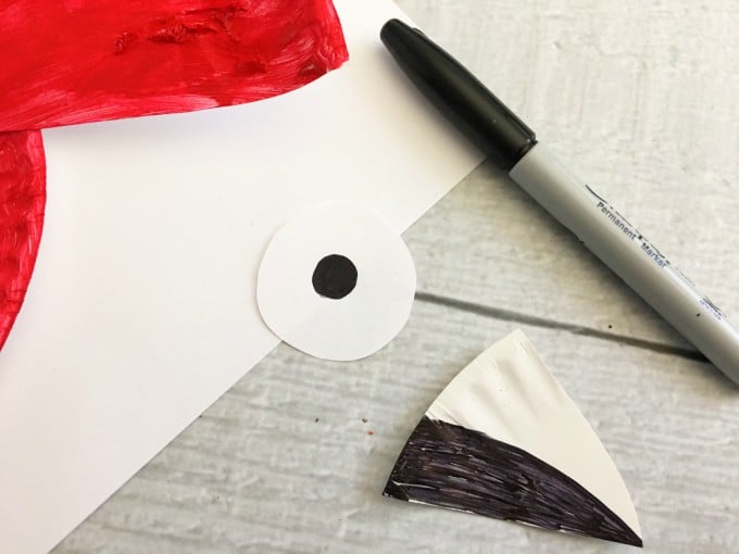 Cut out a small circle and triangle-shaped beak from your leftover plate draw a dot onto the circle center and color the bottom half of the beak black. : paper plate parrot - pezcame.com