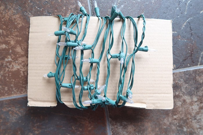 Wrap Christmas lights around cardboard to make them easier to unravel next year.