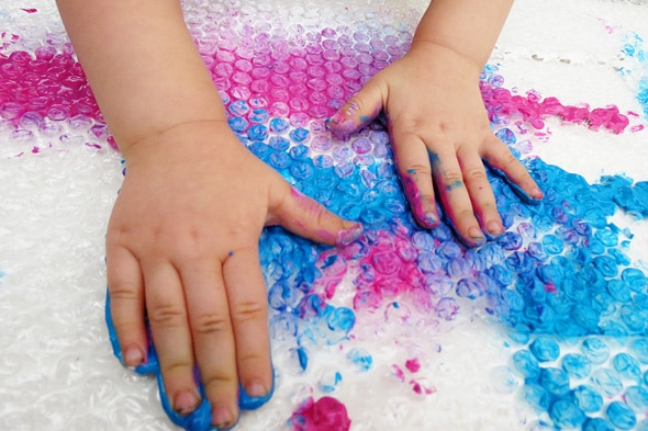 finger painting on bubble wrap