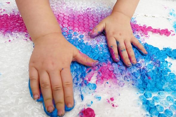 finger painting on bubble wrap