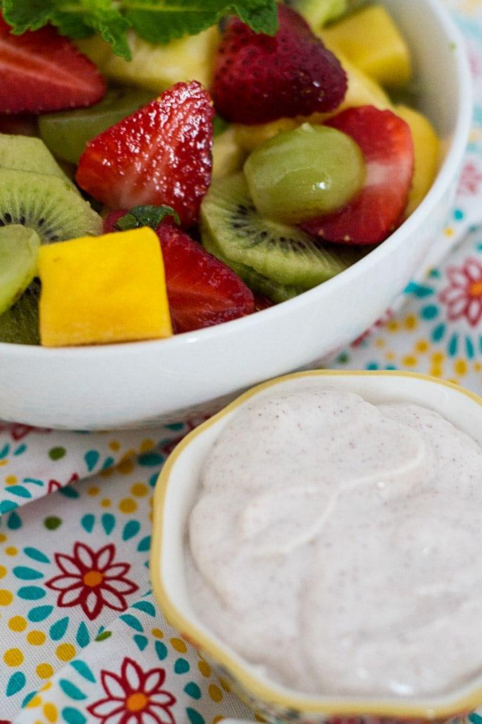 Honey yogurt dip paired with tropical fruit salad