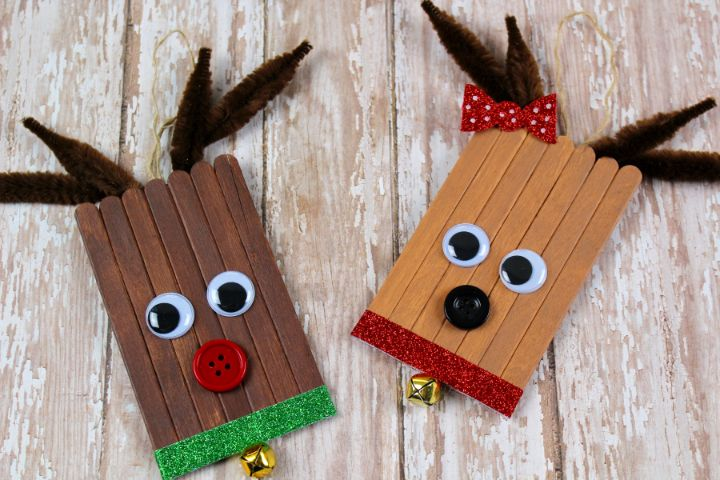 two completed popsicle stick reindeer ornaments
