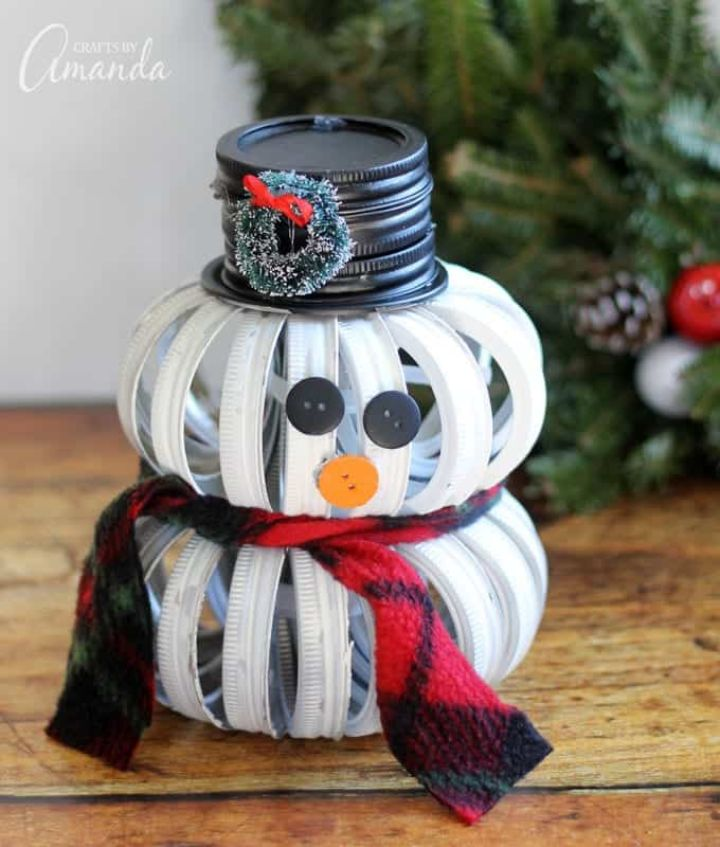 snowman made of painted mason jar lids