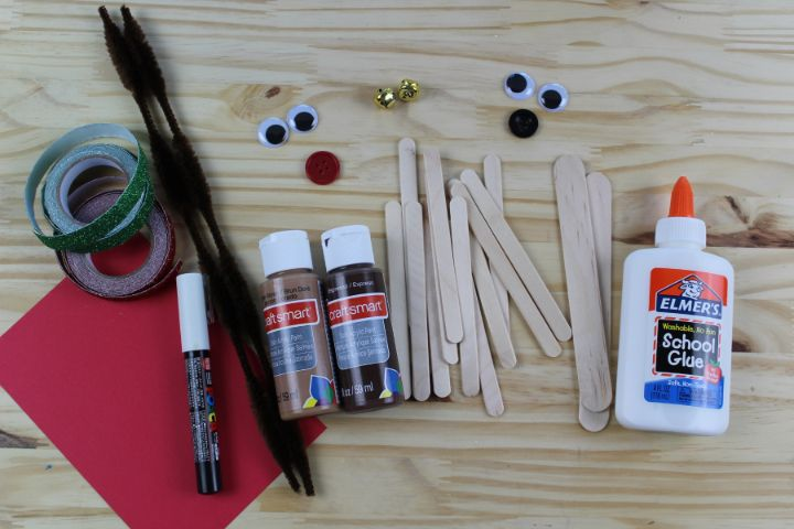 craft supplies to make a popsicle stick reindeer ornament