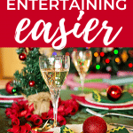 pinterest image featuring wine glasses and a holiday table setting