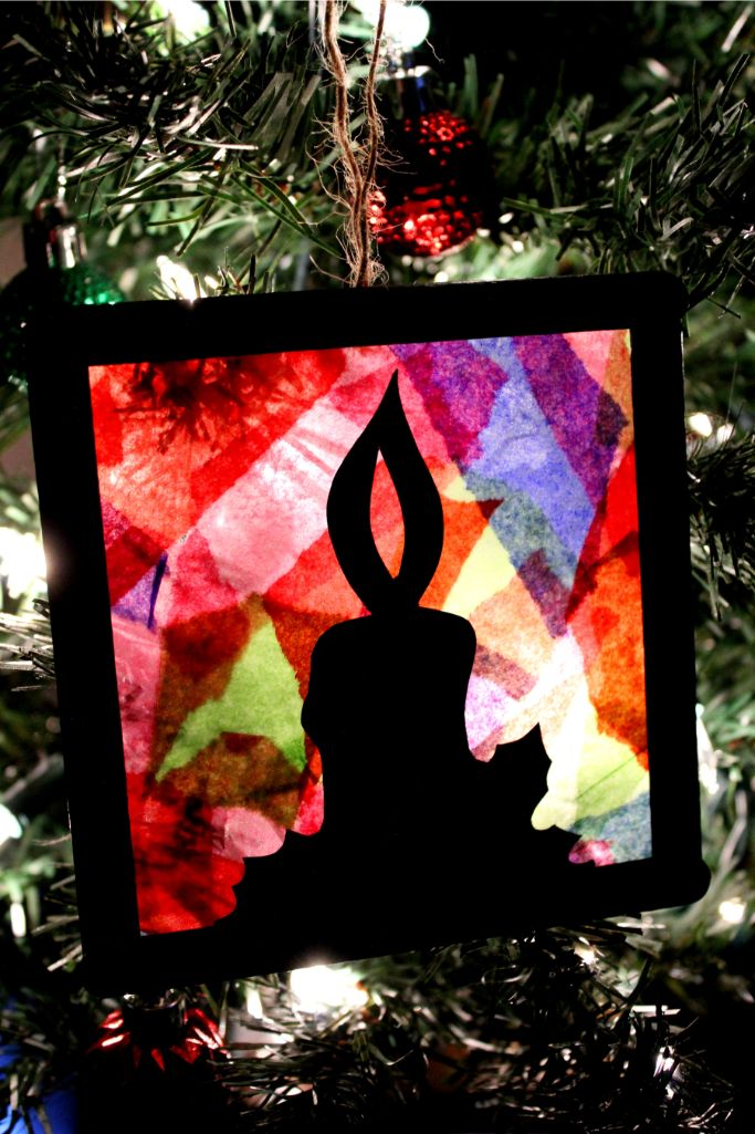stained glass ornament hanging on a tree
