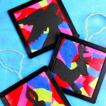 stained glass ornaments on blue background