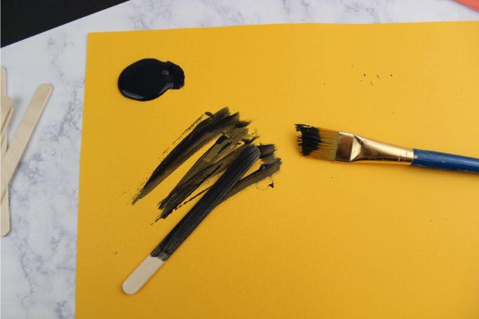 painting popsicle sticks black