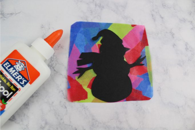 snowman silhouette glued to contact paper