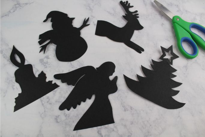 silhouette cut-outs on black cardstock