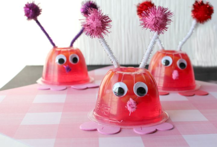 love bug snack cups on a pink checkered background