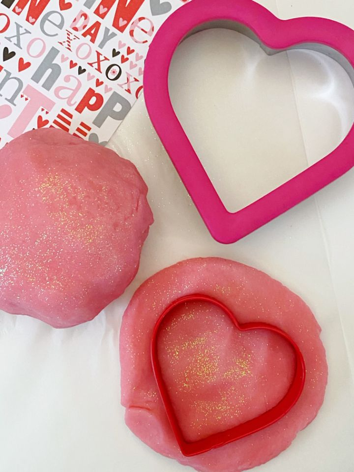 pink playdough with heart shaped cookie cutter vertical