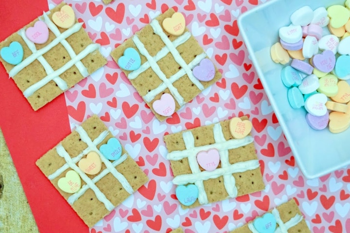 finished valentine's day tic tac toe snacks on a heart background