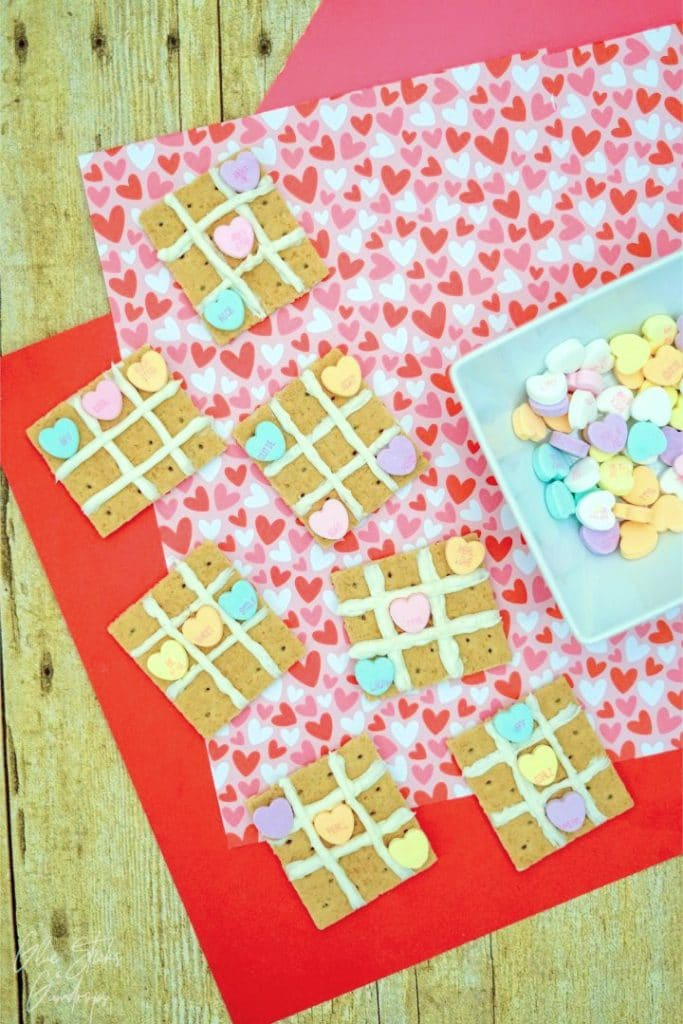 graham cracker tic tac toe snacks on a heart background