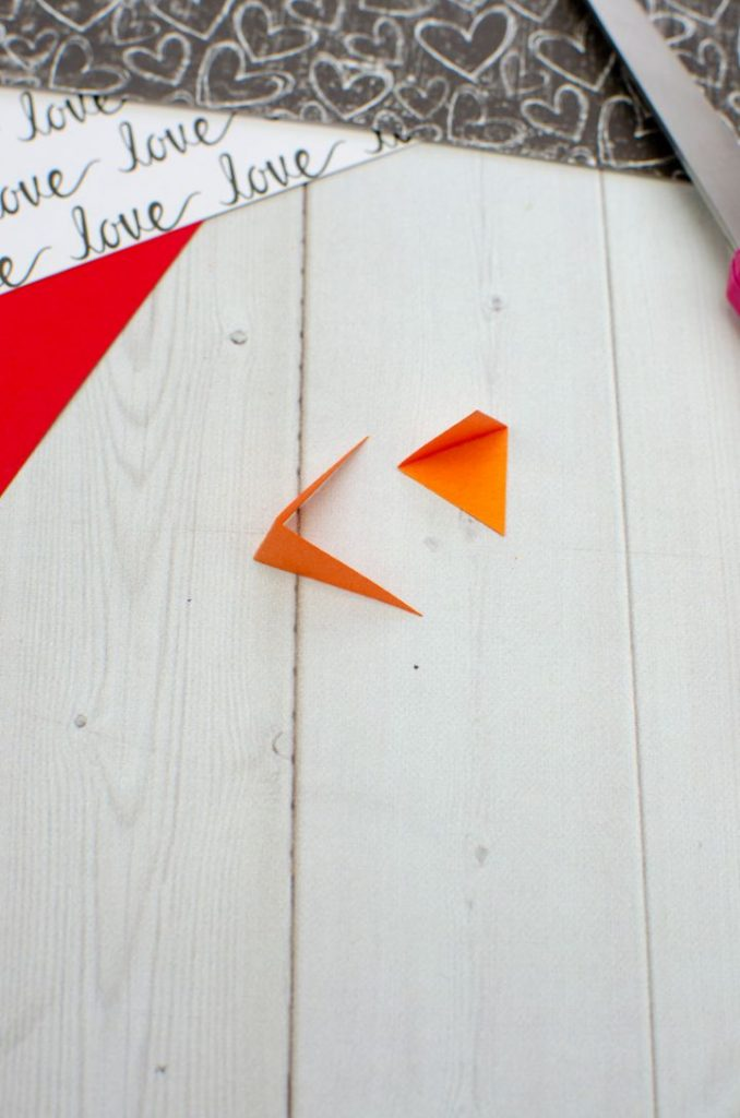 orange paper folded to make beaks
