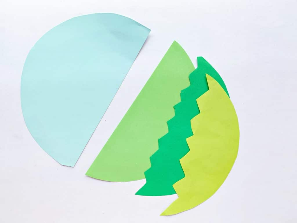 cut pieces of paper for the sky and grass for this craft