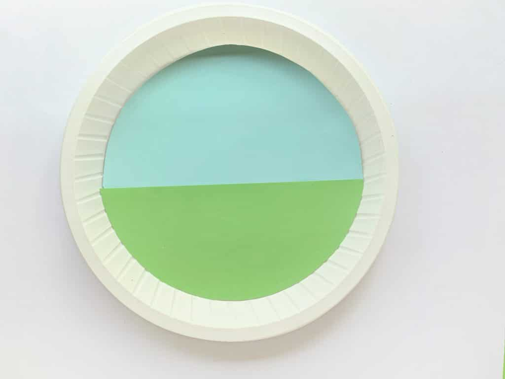 sky and grass background on paper plate