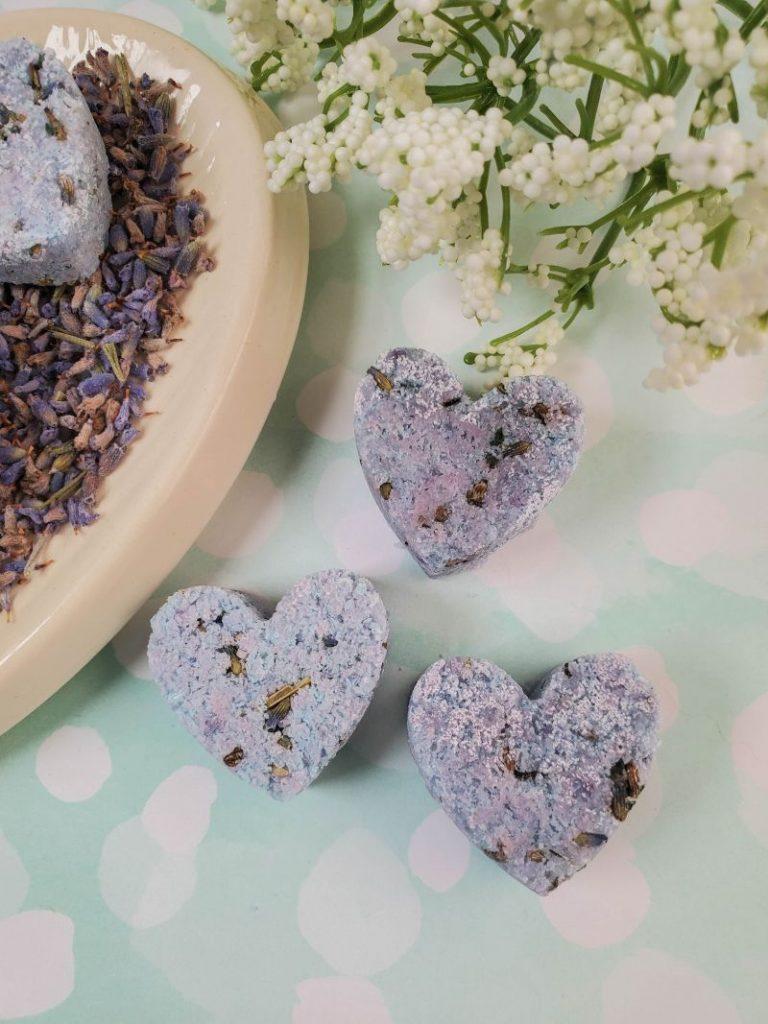 heart-shaped lavender shower melts on a light background