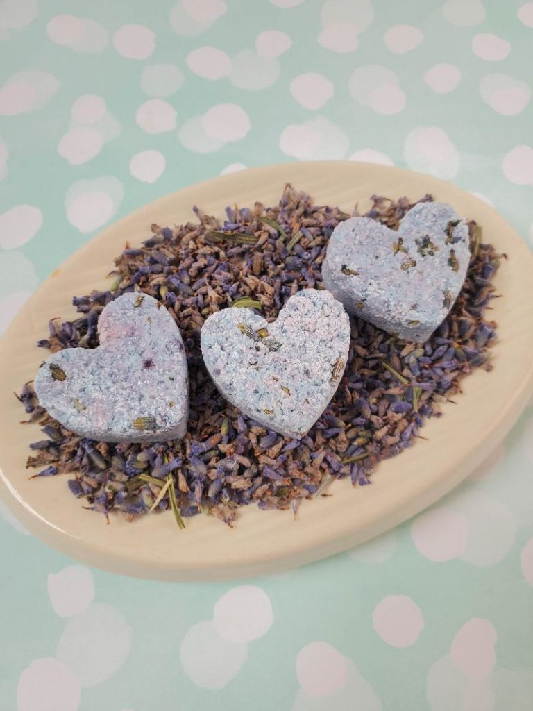 heart-shaped shower melts made with Epsom salts, lavender essential oil, dried lavender, etc.