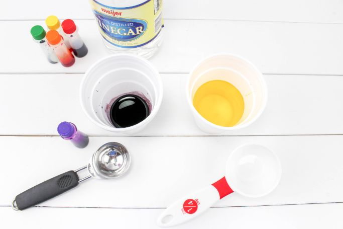 food coloring and vinegar added to cups