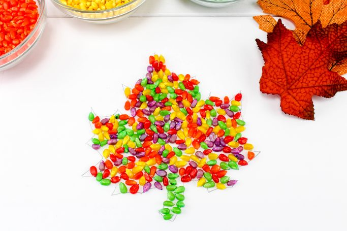 fall leaf made out of dyed popcorn kernels