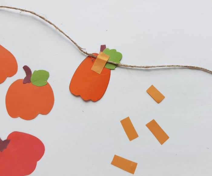 attaching pumpkins to the twine