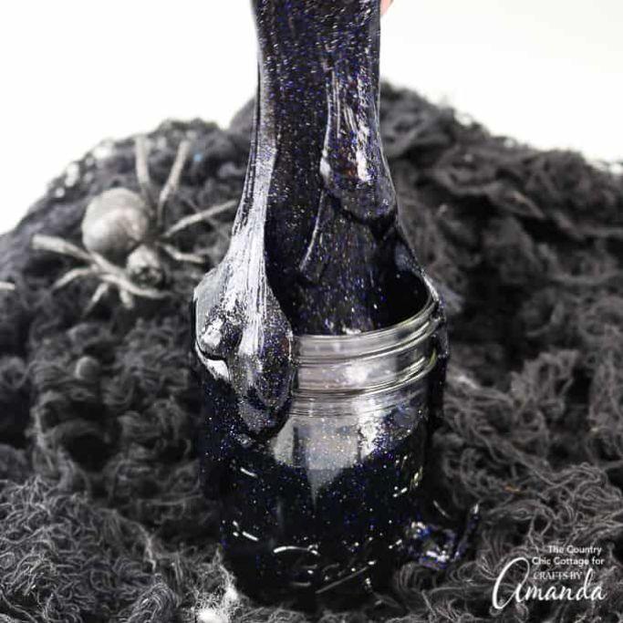 black glitter slime in a jar