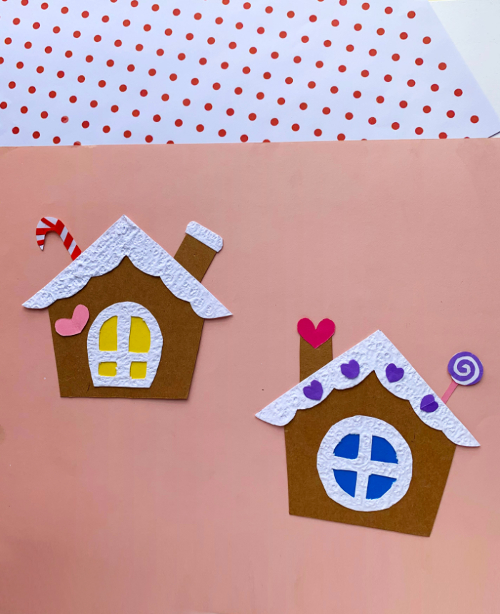 paper gingerbread houses on a pink background