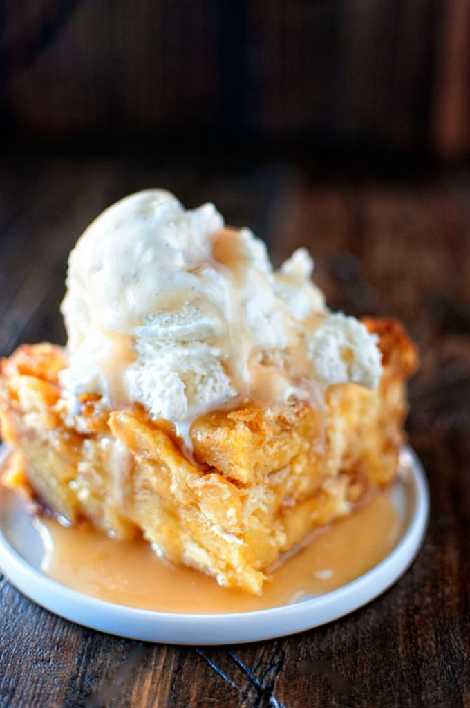 festive eggnog bread pudding topped with ice cream
