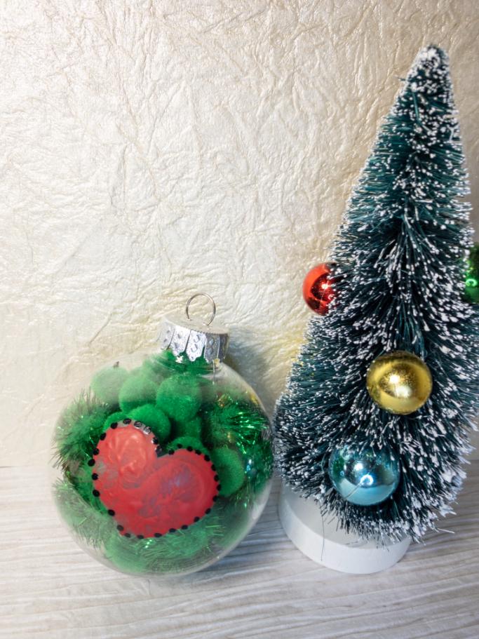 final vertical grinch ornament beside miniature Christmas tree