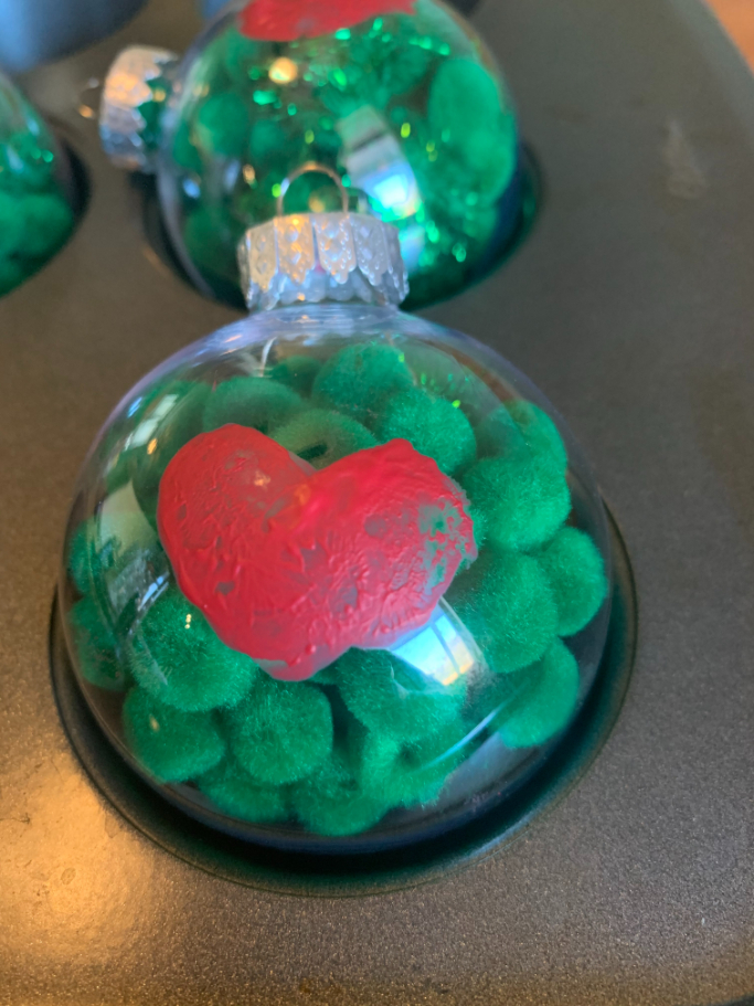 letting the homemade grinch ornaments dry