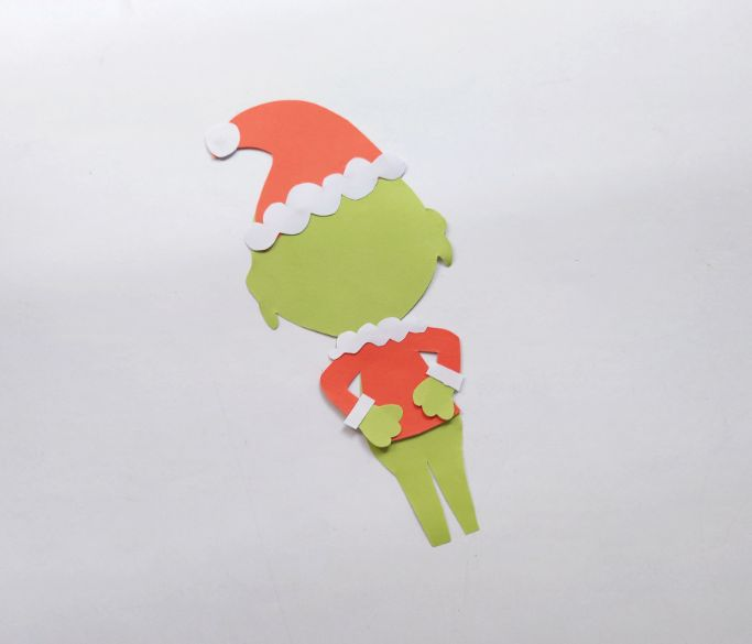 gluing the Grinch's hat on