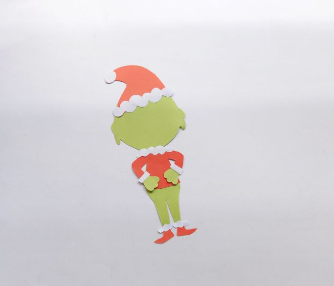 gluing the Grinch's shoes to his feet