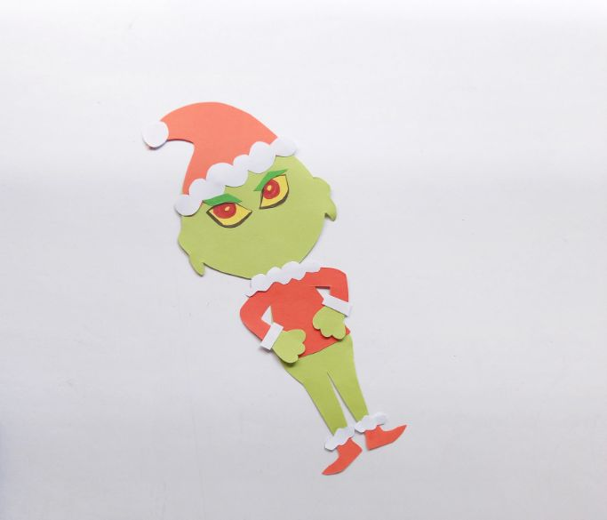 gluing eyes and eyebrows on the Grinch's face