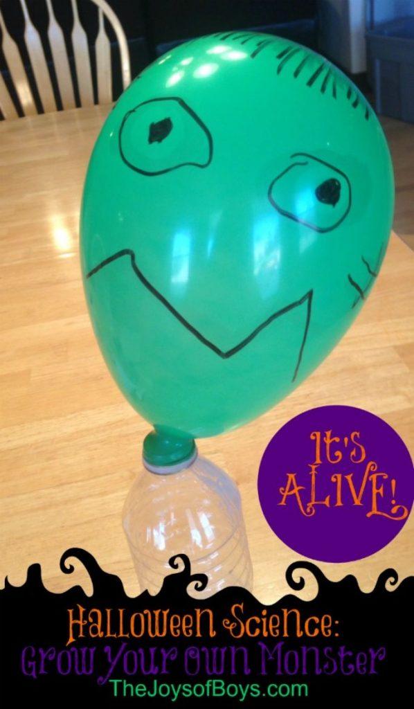 green balloon with monster face on bottle of baking soda vinegar solution