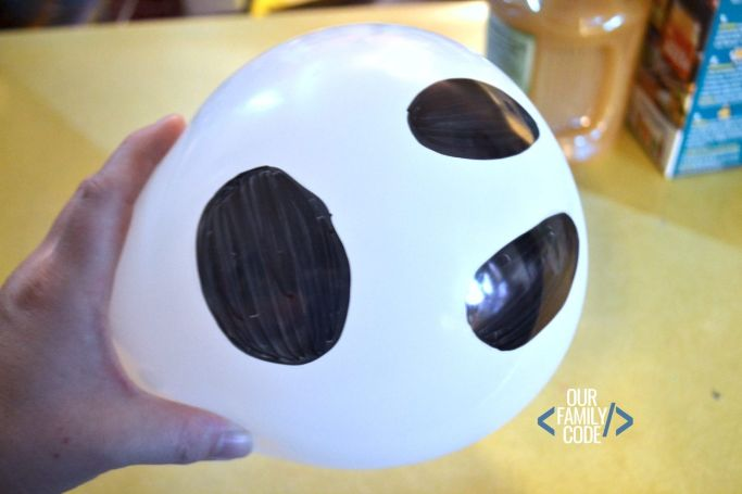 balloon with ghost face used in an experiment